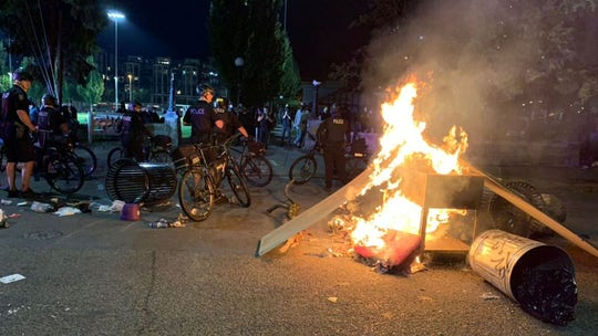 Seattle police arrest 10 for assaulting cops, smashing windows, setting fires