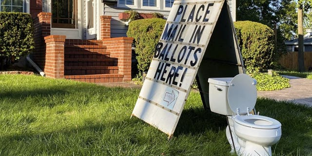 This political yard display was recently set up on West Columbia Street in Mason, Mich. (Matthew Dae Smith/Lansing State Journal via AP)