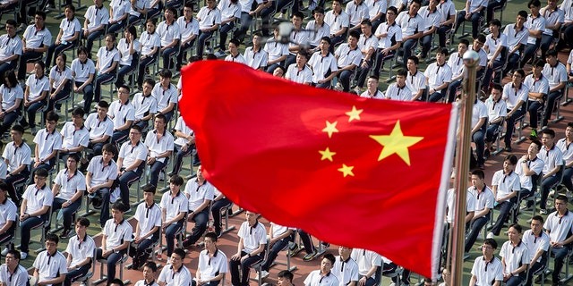 Students attend a ceremony to kick off the new semester in Wuhan High School in Wuhan in central China's Hubei province Tuesday, Sept. 1, 2020. (Chinatopix Via AP)