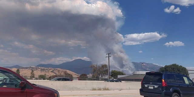 A plume of smoke from the El Dorado Fire is seen from the Interstate 10 in Loma Linda Calif. Saturday Sept. 5 2020