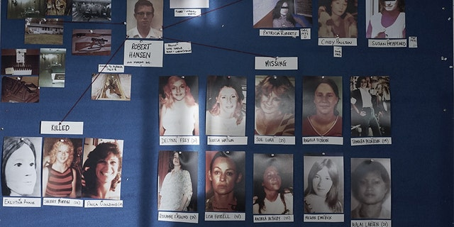 The murder and missing board showing photos of Hansen's victims and crime scene photos.