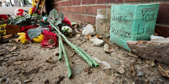 A memorial for James Scurlock remains on Wednesday near where he was shot and killed on May 30, in Omaha, Neb. A warrant is expected to be issued for the white bar owner who fatally shot him. AP Photo/Nati Harnik)