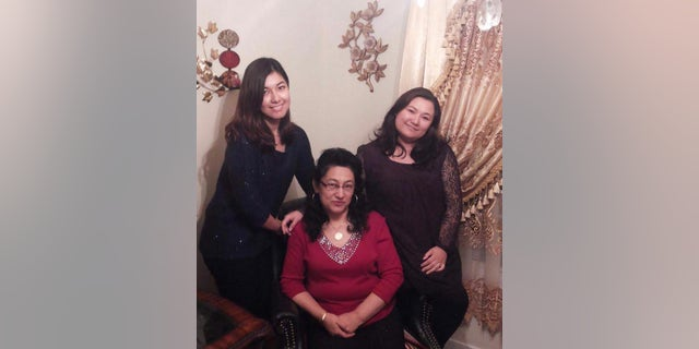 "Happier times: Murat (right) and her sister Zamira (left) with their mother Dr. Gulshan Abbas, before she ""disappeared"" in the Muslim-majority Xinjiang region of China in 2018."