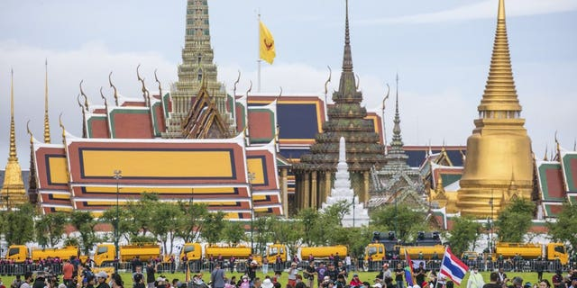 Pro-democracy protesters gather at the Sanam Luang field during a protest in Bangkok, Thailand, Sunday, Sept. 20, 2020. Thousands of demonstrators turned out Saturday for a rally to support the student-led protest movement's demands for new elections and reform of the monarchy. (AP Photo/Wason Wanichakorn)