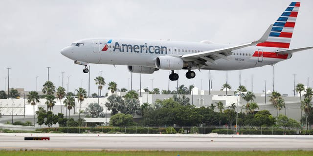 FILE: An American Airlines Boeing 737-823 lands at Miami International Airport, Monday, July 27, 2020, in Miami.