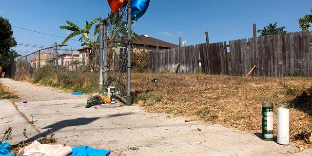 Balloons, candles and flowers are left on Tuesday as a memorial for Dijon Kizzee where he was fatally shot by Los Angeles sheriff's deputies the day before in the Westmont section of Los Angeles. (AP Photo/Stefanie Dazio)