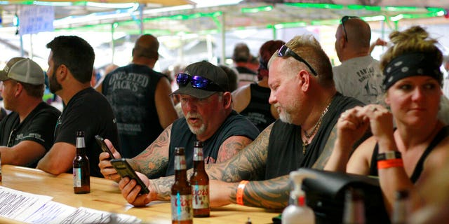In this Aug. 7 file photo, people congregate at One-Eyed Jack's Saloon during the 80th annual Sturgis Motorcycle Rally in Sturgis, S.D. (AP Photo/Stephen Groves File)