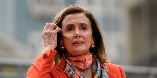 House Speaker Nancy Pelosi pulls back her hair while speaking about her visit to a hair salon during a news conference at the Mission Education Center Elementary School Wednesday, Sept. 2, 2020, in San Francisco. (AP Photo/Eric Risberg)