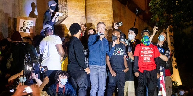 Portland Mayor Ted Wheeler speaks to Black Lives Matter protesters in Portland, Ore., in July. (Associated Press)