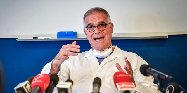 Alberto Zangrillo, Silvio Berlusconi's longtime physician, talks to reporters at the San Raffaele hospital in Milan, Friday, Sept. 4, 2020.  (Claudio Furlan/LaPresse via AP)