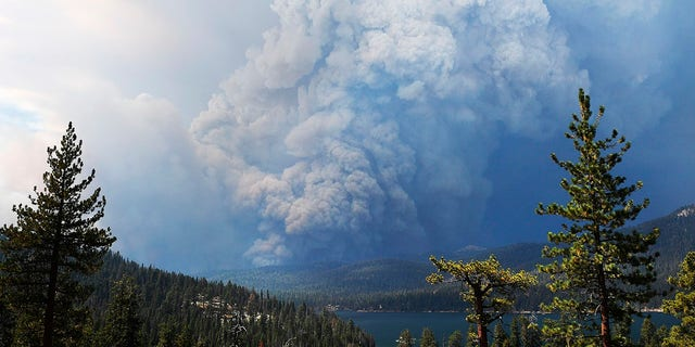 Clouds of smoke soar as wildfire burns on the hillsides near Shaver Lake, California on Saturday, September 5, 2020.  (Associated Press)