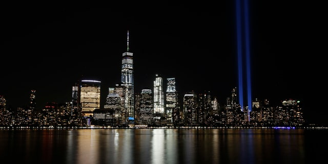 In this Sept. 11, 2017, file photo, the Tribute in Light illuminates in the sky above the Lower Manhattan area of New York, as seen from across the Hudson River in Jersey City, N.J.  (AP Photo/Jason DeCrow, File)