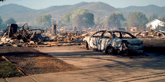 This photo taken by Talent, Ore., resident Kevin Jantzer shows the destruction of his hometown in the aftermath of wildfires that ravaged the central Oregon town near Medford, Sept. 9. (Kevin Jantzer via AP)