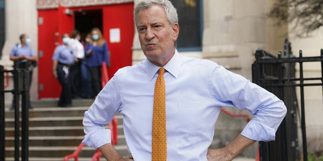 In this Aug. 19, 2020, file photo, New York Mayor Bill de Blasio speaks to reporters after visiting New Bridges Elementary School in the Brooklyn borough of New York, to observe pandemic-related safety procedures. (AP Photo/John Minchillo, File)