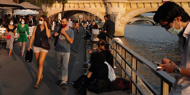 France has seen a sharp increase in new cases in recent weeks and hospitalizations have started to steadily increase, now reaching over 5,000 including 615 people in intensive care. (AP Photo / Francois Mori)
