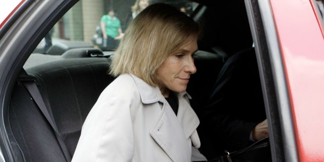 In this May 15, 2009, then-acting U.S. Attorney Nora Dannehy leaves law offices in Washington. Dannehy, a federal prosecutor who was helping lead the investigation into the origins of the Trump-Russia probe has resigned from the Justice Department. (AP Photo/Haraz N. Ghanbari, File)