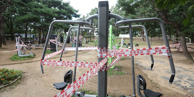 The use of public sports facilities is banned amid social distancing rules at a park in Goyang, South Korea, Sunday, Sept. 13, 2020. (AP Photo/Ahn Young-joon)
