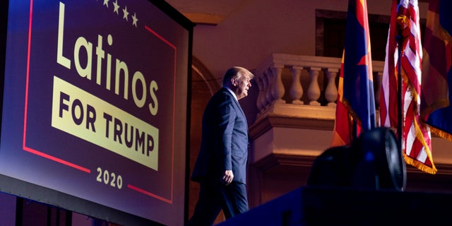 President Donald Trump arrives for a Latinos for Trump Coalition roundtable at Arizona Grand Resort & Spa, Monday, Sept. 14, 2020, in Phoenix. (AP Photo/Andrew Harnik)