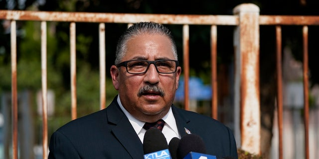 Ron Hernandez speaks to reporters outside St. Francis Medical Center on Monday in Lynwood, Calif., where two Los Angeles County Sheriff's deputies are hospitalized after being shot. (AP Photo/Ashley Landis)