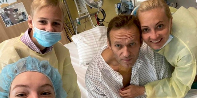 This handout photo published by Russian opposition leader Alexei Navalny on his instagram account, shows himself, centre, and his wife Yulia, right, daughter Daria, and son Zakhar, top left, posing for a photo in a hospital in Berlin, Germany.(Navalny instagram via AP)