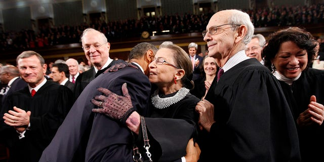 Then-President Barack Obama hugs Supreme Court Justice Ruth Bader Ginsburg on Capitol Hill in Washington, prior to his State of the Union address, Jan. 25, 2011. From left are Chief Justice John Roberts, Justice Anthony Kennedy, Obama, Justice Ginsburg and Justice Stephen Breyer. (Associated Press)