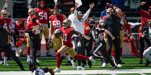 San Francisco 49ers running back Raheem Mostert (31) runs 80 yards for a touchdown during the first half of an NFL football game against the New York Jets, Sunday, Sept. 20, 2020, in East Rutherford, N.J. (AP Photo/Corey Sipkin)