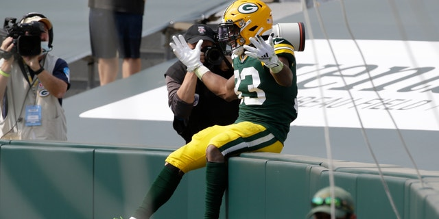 Green Bay Packers' Aaron Jones celebrates his touchdown catch during the first half of an NFL football game against the Detroit Lions Sunday, Sept. 20, 2020, in Green Bay, Wis. (AP Photo/Mike Roemer)
