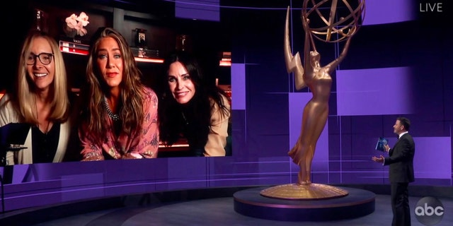 In this video grab captured on Sept. 20, 2020, courtesy of the Academy of Television Arts & Sciences and ABC Entertainment, Jimmy Kimmel, right, speaks with actors, from left, Lisa Kudrow, Jennifer Aniston and Courteney Cox during the 72nd Emmy Awards broadcast. (The Television Academy and ABC Entertainment via AP)
