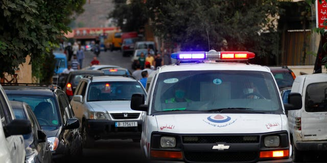 A Hezbollah civil defense ambulance passes on a road that leads to the site of an explosion that rocked a Hezbollah stronghold. (AP Photo/Mohammed Zaatari)