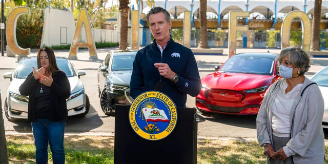 California Gov. Gavin Newsom speaks at a press conference on Wednesday, Sept. 23, 2020, at Cal Expo in Sacramento where he announced an executive order requiring the sale of all new passenger vehicles to be zero-emission by 2035. (Daniel Kim/The Sacramento Bee via AP, Pool)