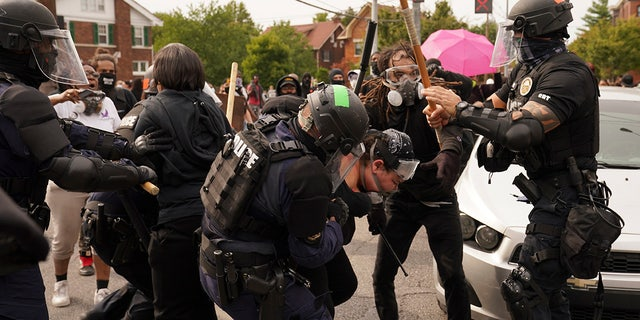 Police and protesters converge, Wednesday, Sept. 23, 2020, in Louisville, Ky.  (AP Photo/John Minchillo)