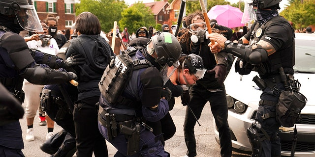 Police and protesters converge, Wednesday, Sept. 23, 2020, in Louisville, Ky. (Associated Press)