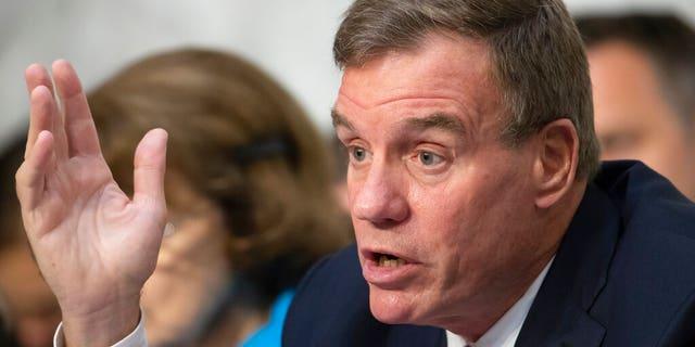 FILE - This Wednesday July 25, 2018 file photo shows Sen. Mark Warner, D-Va., vice-chair of the Senate Intelligence Committee, in Washington. (AP Photo/J. Scott Applewhite)