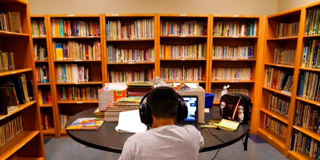 A Los Angeles Unified School District student attends an online class at Boys & Girls Club of Hollywood in Los Angeles. (AP Photo/Jae C. Hong, File)