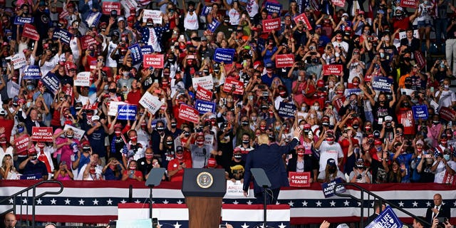President Donald Trump acknowledges supporters after his campaign rally, Thursday, Sept. 24, 2020, in Jacksonville, Fla. (AP Photo/Stan Badz)
