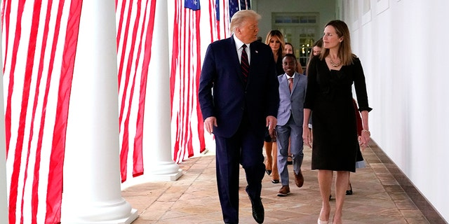 President Trump walks along the White House Colonnade with Judge Amy Coney Barrett after nominating her to the Supreme Court. (AP Photo/Alex Brandon)