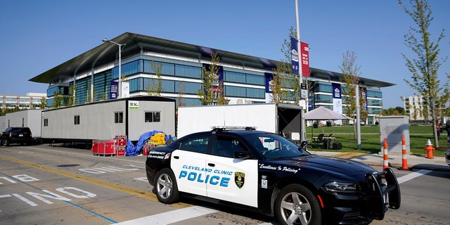 A police cruiser rolls by the Health Education Campus of Case Western Reserve University ahead of the first presidential debate between Republican candidate President Donald Trump and Democratic candidate former Vice President Joe Biden on Tuesday. Some local businesses are boarding up in case riots erupt after the event. (AP Photo/Julio Cortez)