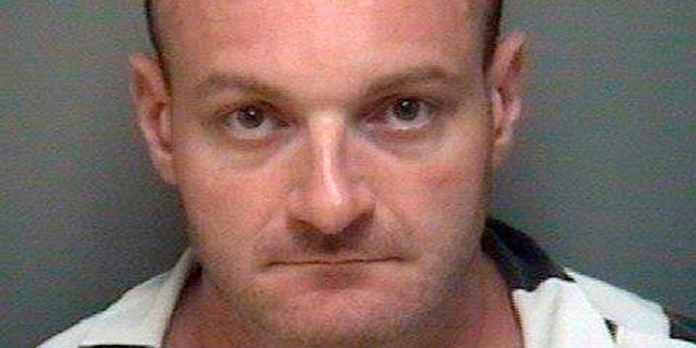 This undated booking file photo provided by the Albemarle-Charlottesville Regional Jail shows Christopher Cantwell, of New Hampshire. On Monday, Sept. 28, 2020, a federal jury in Concord, N.H., found a Cantwell guilty of threatening to rape the wife of a man who was part of a racist group he felt was harassing and bullying him. (Albemarle-Charlottesville Regional Jail via AP, File)