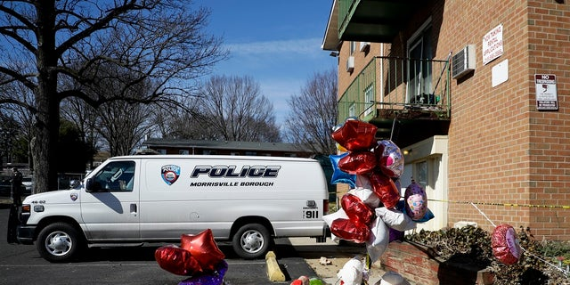 A makeshift memorial is seen outside the Robert Morris Apartments in Morrisville, Bene. Shana Decree, 47, and Dominique Decree, 21, were sentenced in Bucks County Court after entering guilty but mentally ill pleas to five counts of first-degree murder. (AP Photo/Matt Slocum, File)