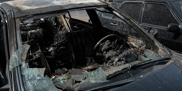 A car destroyed by shelling in Stepanakert, the self-proclaimed Republic of Nagorno-Karabakh, Azerbaijan, Tuesday, Sept. 29, 2020. Armenian and Azerbaijani forces accused each other of attacks on their territory Tuesday, as fighting over the separatist region of Nagorno-Karabakh continued for a third straight day following the reigniting of a decades-old conflict. (Areg Balayan/PAN Photo via AP)
