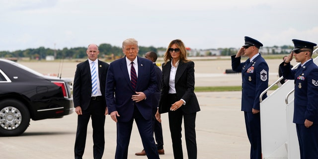 President Donald Trump and first lady Melania Trump arrive at Cleveland Hopkins International Airport for the first presidential debate, Tuesday, Sept. 29, 2020, in Cleveland. (AP Photo/Evan Vucci)
