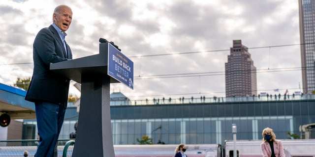 Democratic presidential candidate former Vice President Joe Biden, accompanied by his wife Jill Biden, right, speaks at Amtrak's Cleveland Lakefront train station, Wednesday, Sept. 30, 2020, in Cleveland, Biden is on a train tour through Ohio and Pennsylvania today. (AP Photo/Andrew Harnik)