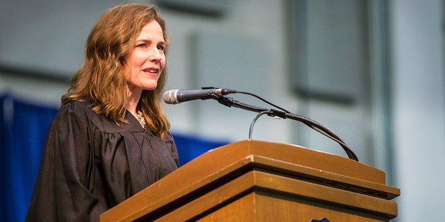 In this May 19, 2018, photo, Amy Coney Barrett, United States Court of Appeals for the Seventh Circuit judge, speaks during the University of Notre Dame's Law School commencement ceremony at the University of Notre Dame in South Bend, Ind. Barrett is considered one of the most likely picks to fill the vacant Supreme Court seat of late Justice Ruth Bader Ginsburg. (Robert Franklin/South Bend Tribune via AP)