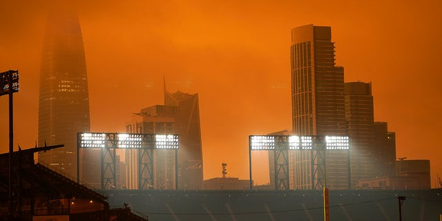 The skyline in the distance behind Oracle Park is partially visible with smoke from wildfires late Wednesday afternoon Sept. 9, 2020, in San Francisco. (Associated Press)