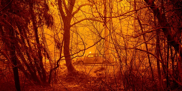 A scorched car rests in a clearing following the Bear Fire in Butte County, Calif., on Wednesday, Sept. 9, 2020.