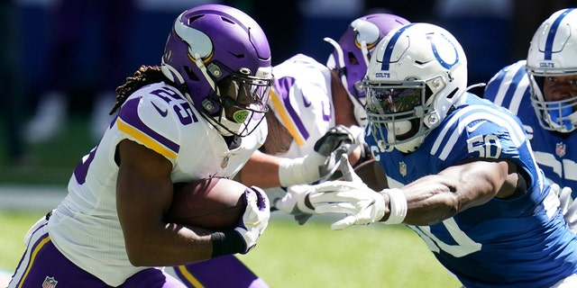 Minnesota Vikings' Alexander Mattison (25) runs past Indianapolis Colts' Justin Houston (50) during the first half of an NFL football game, Sunday, Sept. 20, 2020, in Indianapolis. (AP Photo/Michael Conroy)