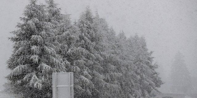 A car makes his way through heavy snow on motorway A 13 in Noesslach near Innsbruck, Austria, Friday, Sept. 25, 2020.