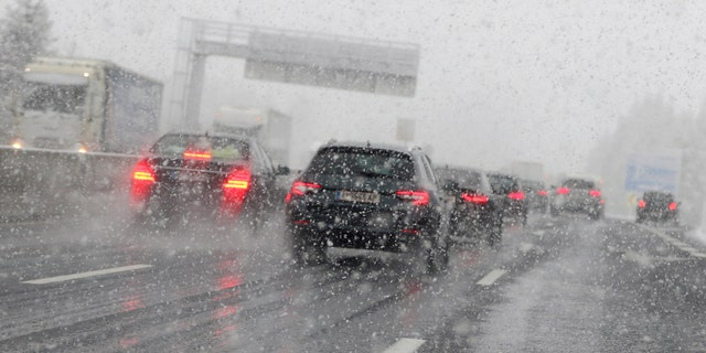 Cars make their way through heavy snow on motorway A 13 in Noesslach near Innsbruck, Austria, Friday, Sept. 25, 2020.
