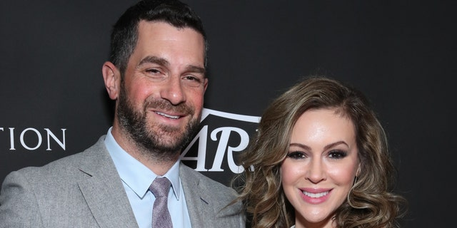 Alyssa Milano (right) and her husband Dave Bugliari (left). The actress said that her husband called the police to ask when they'd be arriving after a neighbor made the initial call to law enforcement. (Photo by Rich Fury/Getty Images)