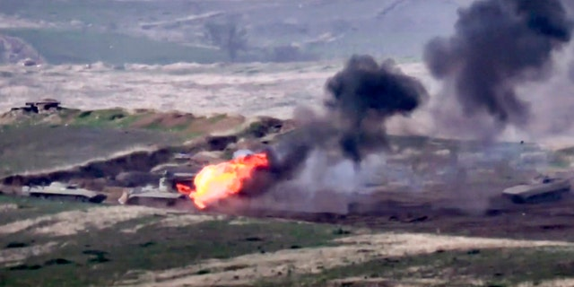 In this image taken from a footage released by Armenian Defense Ministry on Sunday, 씨족. 27, 2020, Armenian forces destroy Azerbaijani military vehicle at the contact line of the self-proclaimed Republic of Nagorno-Karabakh, Azerbaijan.